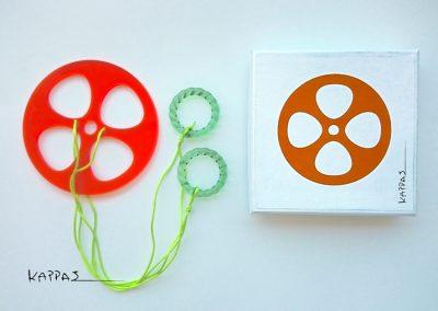spinning-toy-orange-+-box